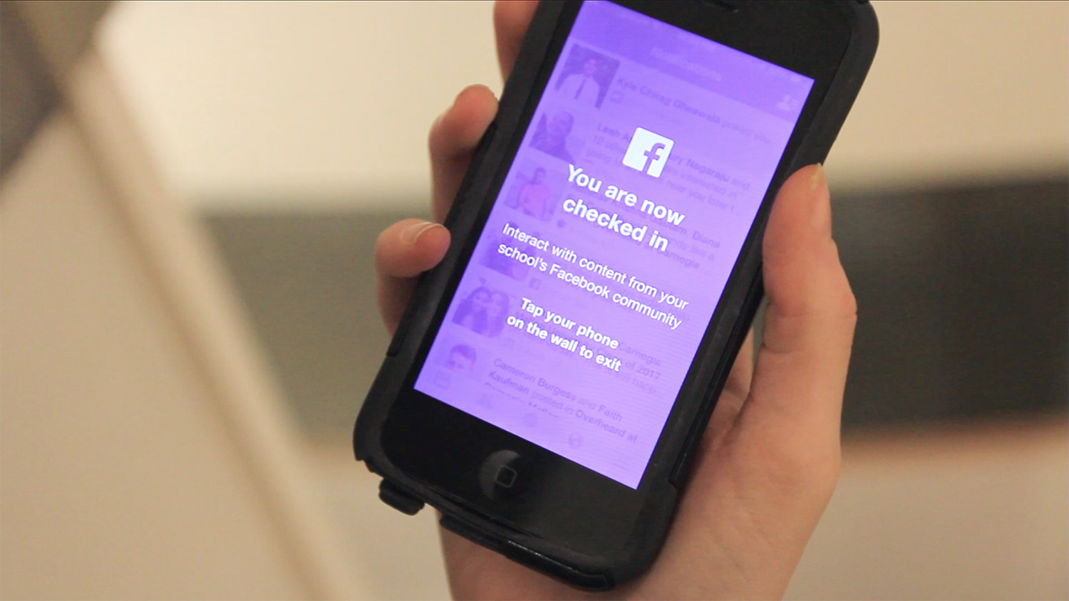 Facebook's new feature, the purple hashtag, leads users to the wall and is their entryway to the product. Once they tap their phone to sign in at the wall, however, their Facebook mobile app will be blocked from any activity so they are prompted to interact with the wall and be physically engaged.