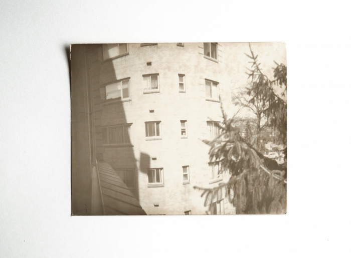 Pinhole image of an apartment building